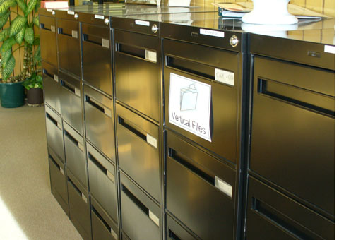 The black filing cabinets contain manila folders on a wide variety of  subjects. The folders contain pamphlets, maps, posters, magazine articles  and ...